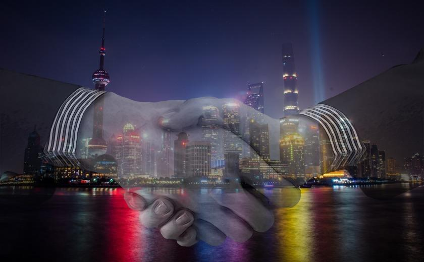Handshake with Shanghai China skyline
